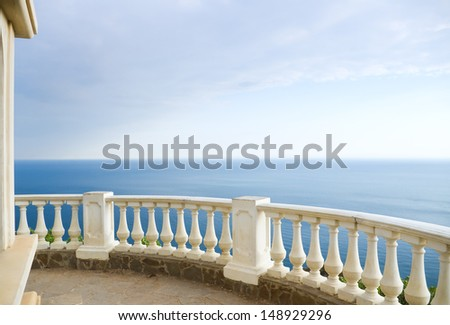 Kind on ocean from a stone balcony