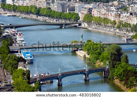 Kind on the river Seine with three bridges, Paris, France