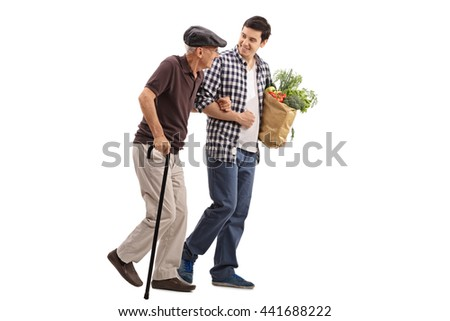 Kind young man helping a senior gentleman with his groceries isolated on white background - stock photo