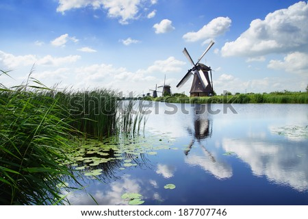 KINDERDIJK, HOLLAND - AUGUST 03, 2012: Windmill. In most of the mills in Kinderdijk still live people. The windmills of Kinderdijk have been a UNESCO World Heritage Site since 1997 - stock photo
