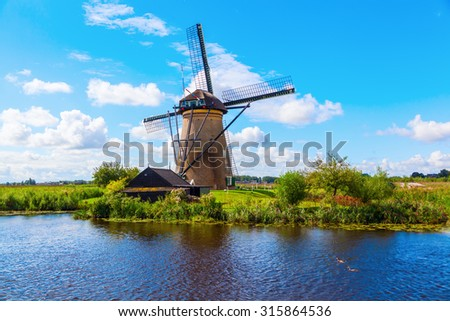 KINDERDIJK, NETHERLANDS - SEPTEMBER 04, 2015: windmills at Kinderdijk. The windmills of Kinderdijk are one of the best-known Dutch tourist sites. They have been a UNESCO World Heritage Site since 1997 - stock photo