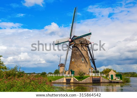 KINDERDIJK, NETHERLANDS - SEPTEMBER 04, 2015: windmills at Kinderdijk. The windmills of Kinderdijk are one of the best-known Dutch tourist sites. They have been a UNESCO World Heritage Site since 1997