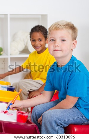 kindergarten boys in classroom - stock photo
