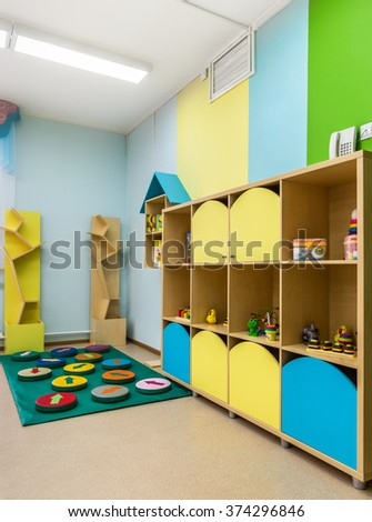 Kindergarten, toys on the shelves.