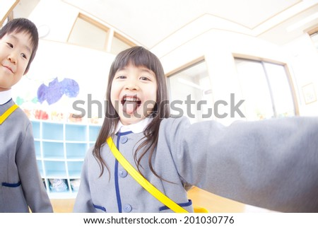 kindergartener man and woman acting cutely - stock photo