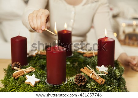 Kindle first candle on the third Advent - stock photo