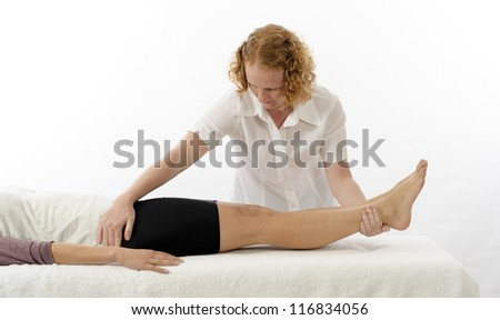 Kinesiologist or physiotherapist treating Adductors - stock photo