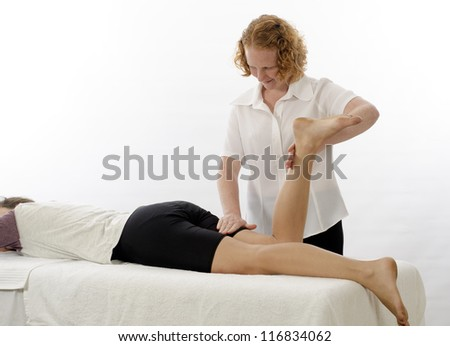 Kinesiologist or physiotherapist treating Hamstrings - stock photo