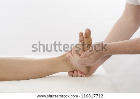 Kinesiologist or physiotherapist treating Peroneus - stock photo