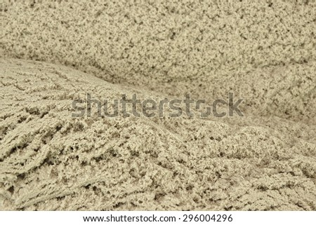Kinetic Sand Heap For Children Indoor Table Game And Creativity Close-up - stock photo