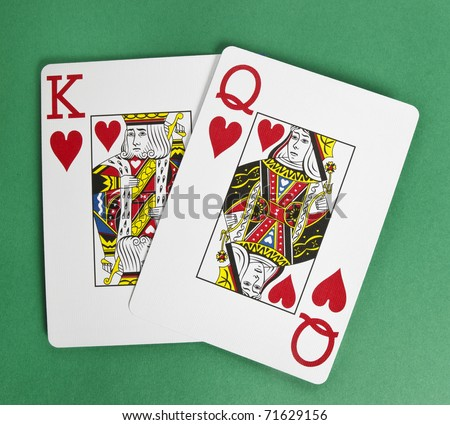 King and Queen of Hearts isolated on green - stock photo