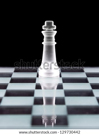 King chess piece over black