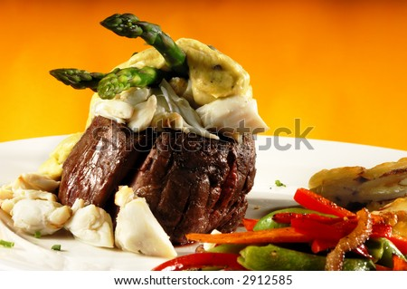King Fillet Mignon Oscar Crab Meat and Vegetables - stock photo
