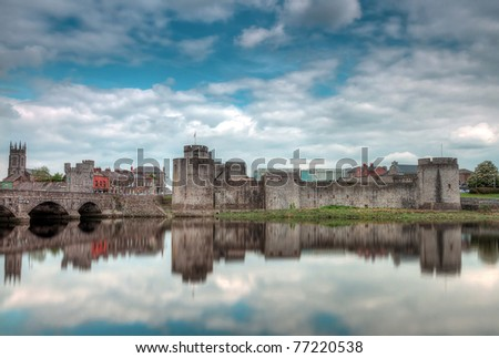 King John Castle in Limerick with reflection in Shannon river - stock photo
