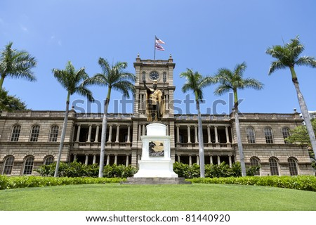 King Kamehameha I Statue, by Thomas Gould, in front of Ali?iolani Hale, the Hawaii Supreme Court Building on King Street in Honolulu. - stock photo