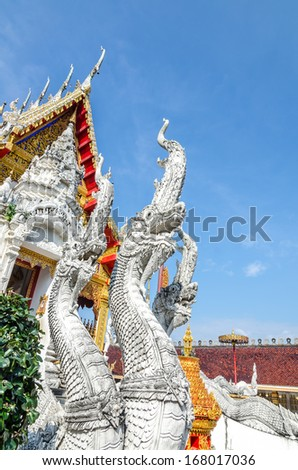 King of Nagas statue with temple background
