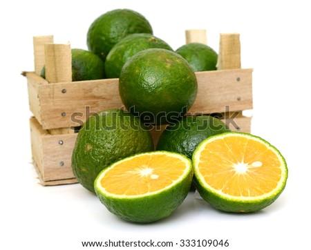 King Orange fruit in a wooden box on white background - stock photo