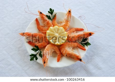 King prawns with fresh lemon and parsley tapas, Costa del Sol, Malaga Province, Andalusia, Spain, Western Europe. - stock photo