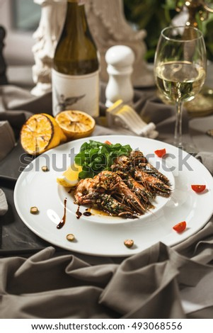 King prawns with salad and wine restaurant supply