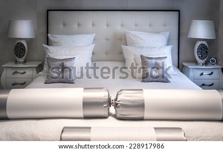 King sized bed in a luxury room - stock photo