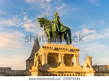 King St Stephen statue at Matthias Church in the rays of the setting sun in Budapest, Hungary - stock photo
