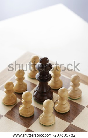 King Threatened by Pawns - stock photo