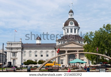 KINGSTON, ONTARIO - SEPTEMBER 5, 2014: Kingston Cityhall, a prominent example of the Neoclassical style in Canada, with a landmark tholobate and dome. At one time, Kingston was capital of Canada. - stock photo
