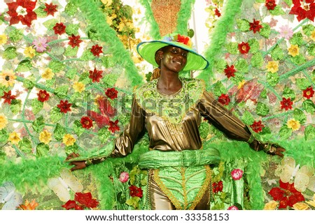 KINGSTOWN - JULY 7: Reveler enjoys Carnival, one of the largest cultural events in the Caribbean  July 7, 2009 in Kingstown, St Vincent & the Grenadines. - stock photo