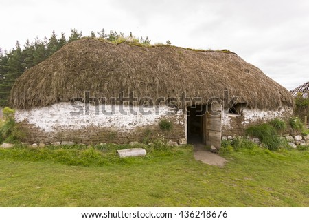 KINGUSSIE & NEWTONMORE, SCOTLAND - AUGUST 26, 2004: Traditional building of turf and thatch, at The Highland Folk Museum.