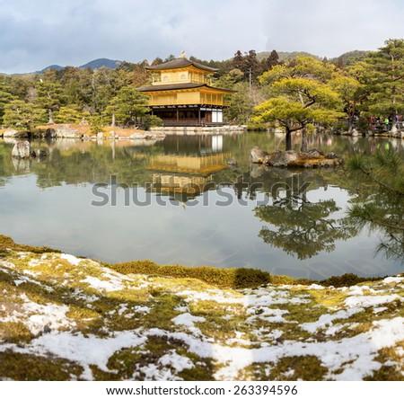 Kinkakuji Temple (The Golden Pavilion) in Kyoto, with snow Japan - stock photo