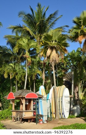 kiosk and some longboard for rent in beautiful scenery - stock photo
