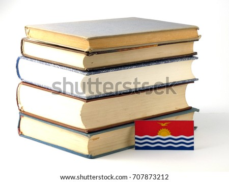 Kiribati flag with pile of books isolated on white background