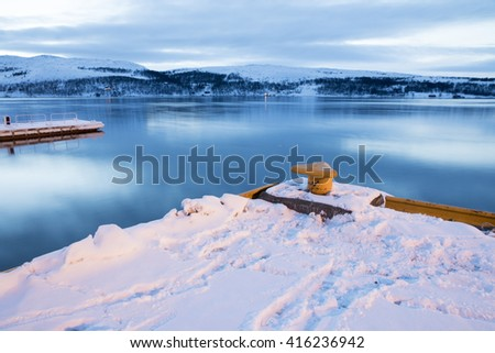 Kirkenes is a town in Sor Varanger municipality in Finnmark county, the far northeaster part of Norway. The harbor at dusk.