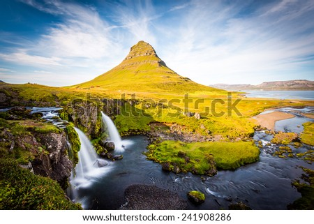 Kirkjufell Mountain, Iceland, Landscape with waterfalls, long exposure in a sunny day, Snaefellsnes peninsula - stock photo