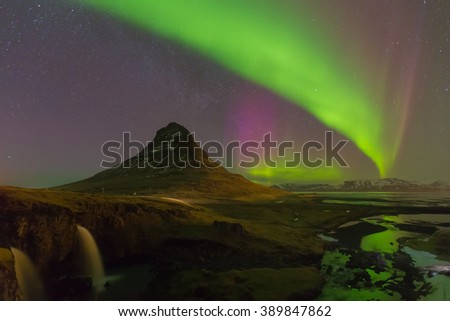 Kirkjufell mountain with beautiful northern lights and fully of star night view, Iceland - stock photo