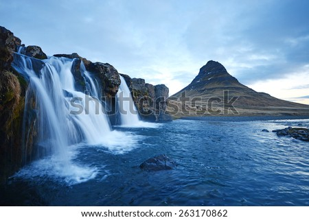 Kirkjufell mountain with waterfall cascades in iceland - stock photo