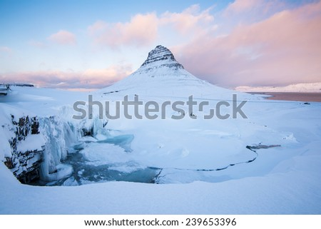Kirkjufell (snow mountain) in Winter season with beautiful and amazing pink and blue sky