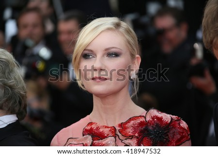 Kirsten Dunst attends the 'Cafe Society' premiere and the Opening Night Gala during the 69th Cannes Film Festival at the Palais des Festivals on May 11, 2016 in Cannes, France. - stock photo