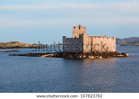 Kisimul castle, Castlebay, Isle of Barra, Outer Hebrides, Scotland. Small medieval castle located on a rocky islet in the bay just off the coast of Barra, completely, surrounded by the sea. - stock photo