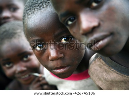 KISORO, UGANDA/EAST AFRICA - January 28th 2009 - Children displaced by the conflict in D R Congo and living with their families in makeshift shelters on the outskirts of Kisoro, Uganda, East Africa. - stock photo