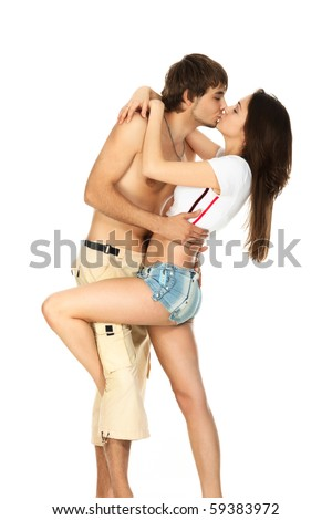 kiss a young couple in love isolated on white - stock photo