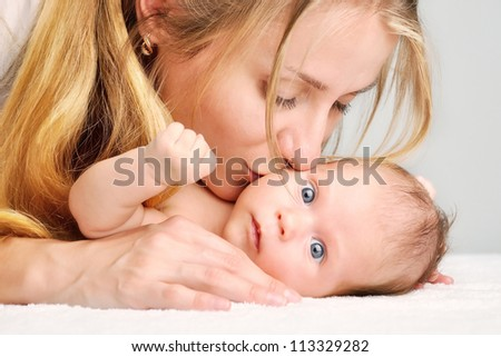 kiss of mother - stock photo