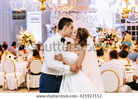 Kiss of the married couple in the luxury restaurant - stock photo