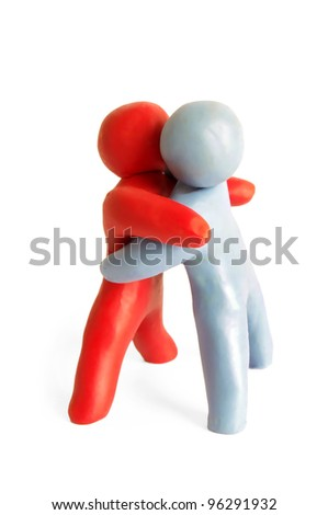 Kiss shake between a two human figures from plasticine - stock photo