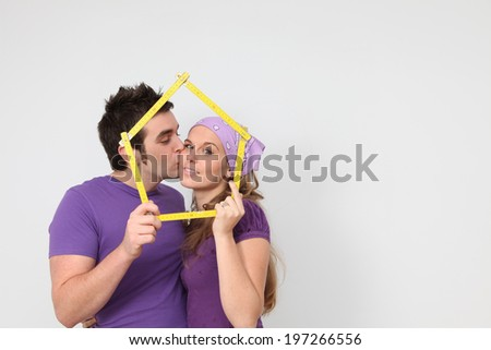 kissing couple getting mortgage loan for new house concept - stock photo