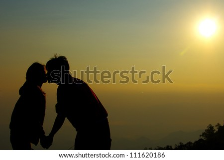 kissing couple in the sunlight