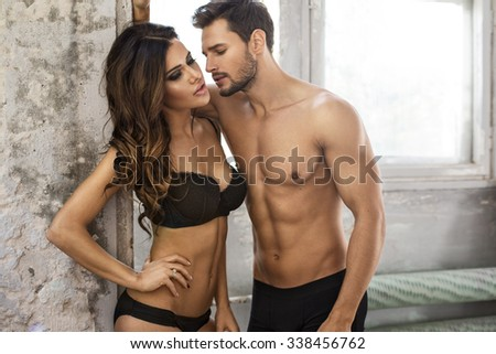 Kissing couple in underwear - stock photo