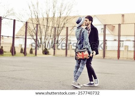 Kissing couple outdoor fashion portrait  - stock photo