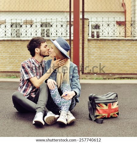 Kissing couple outdoor portrait  - stock photo
