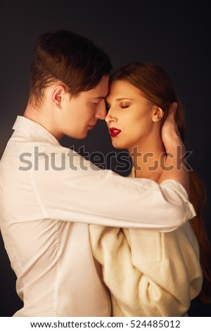 Kissing couple portrait. Hot Sexy couple in love close to each other. Erotic pose. Kissing and hugging.
